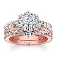 This unique rose gold diamond bridal set features a prong set cushion cut diamond center. The engagement ring is artfully embellished with shared prong set diamond melee that also cascading down the shank for a striking twist on a traditional halo style ring. Two matching shared prong set diamond wedding bands snuggle closely on the sides for a perfect partnership. . Also available in white, yellow gold, 18k and platinum.