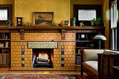 Gorgeous art tile fireplace surround by Motawi. | Old House Journal Heating Month—31 days of tips & advice sponsored by www.unicosystem.com