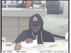 ABERDEEN, Md. - Police are looking for a man who robbed a bank in Harford County Saturday morning.  Police said the suspect robbed the M &T Bank in the 200 block of W. Bel Air Avenue around 11:30 a.m. Saturday.  The suspect was last seen wearing a black Orioles hat, a black hoodie, gray sweat pants and a light color tennis shoes,  Anyone with information is asked to call Aberdeen police at 410-272-2121.