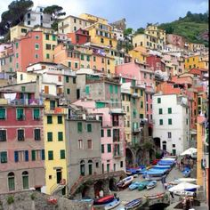 Riomaggiore, Liguria, Italy  One of the most charming towns on earth, Riomaggiore is bursting with color. The pretty sandstone buildings, by maryann