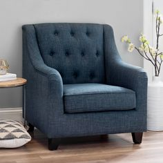 Our Navy Jayla Accent Chair provides an inviting and stylish extra place to sit! You'll love the way its button tufted accents bring a bit of flair your space.