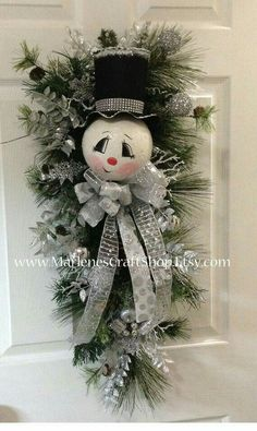 Snowman Swag With Silver Decorations