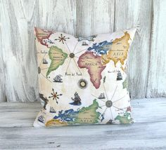 "World map pillow in vibrant color and Italian script by BelleAdora, perfect for the new ""game room."""