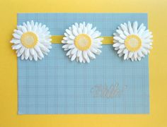 A bright yellow card, silver background and silver sentiment; my favorite daisies are the focus here...