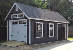 The bold shutters look nice on this 12x24 Garden Manor Cape Garage.