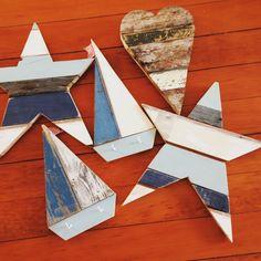 Driftwood sail boats, mermaid, beach hut mobiles, metal fish