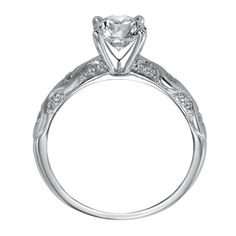 Diamond engagement ring with round center stone and diamonds set in the band with a satin finish.
