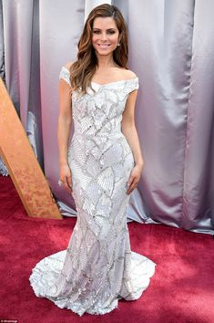 Sterling look: Menounos chose a silver gown that was off the shoulder and had a fan design. Diamond earrings added even more pizzazz