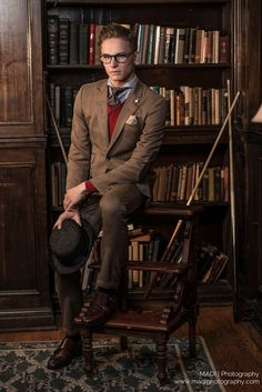 A dapper Curtis in formal wardrobe. Monkstraps in brown, Homburg in hand. Red vest, elbow patches and a balthus knotted tie