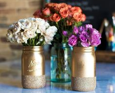 CENTERPIECES: DIY Gold & Glittery mason jars Could do the top gold part a salmon color and have the bottom still glitter gold. Or have it like this and have salmon colored flowers.