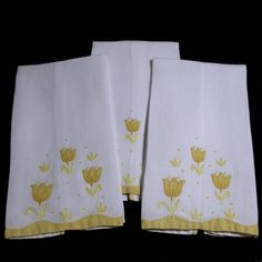 Set of 3 cheery hand towels for a powder room or guest bath. White linen with Yellow applique tulips and border. From the QuirkyCoolTreasures shop at Etsy.com