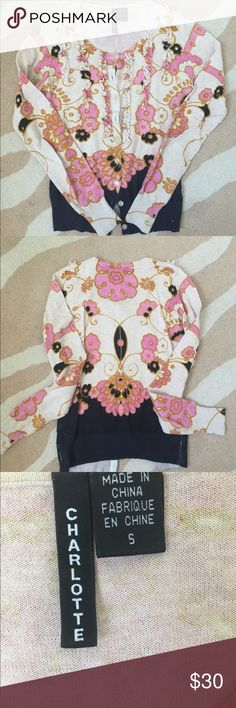 Anthropologie Charlotte cardigan Cardigan with pink and cream flowers. Ruffle accents along the front of the sweater. Navy blue at the bottom. Anthropologie Sweaters Cardigans