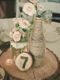 Mason jar, wood slices, twine, and lace: This centerpiece has all the elements required for a rustic-chic country wedding. Photo credit: Sarah Kahn Event Styling