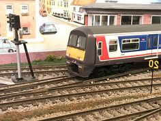 Traction 456011 departs Inglenook South. I need to scratch build some high level pipes to complete the look of the cab area.