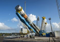 The next pair of spacecraft to join Europe's growing Galileo navigation system, a civilian-run analog to the U.S. military's Global Positioning System, will be added to the tip of a Russian Soyuz booster overnight Monday after the rocket's rollout earlier in the day in French Guiana. The venerable Russian rocket emerged from its assembly hangar just after daybreak Monday and rode on rail tracks for the 2,300-foot trip to the purpose-built Soyuz launch pad at the Guiana Space Center.