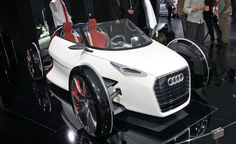 Audi's Urban concept, by contrast, uses an aluminum space frame and a sort of trough made from carbon fiber, which defines the shape of the two seats. Their offset arrangement allows the co-driver to look forward onto the road, and it makes the car wider.