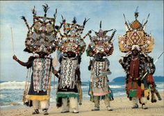 Durban Zulu in Traditional Dress Zulu ricksha pullers resplendent in their finery of painted horns, colourful beads and sheepskin leggings