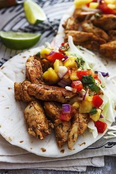 Caribbean Chicken Tacos - these are amazinggg! I just used my grilled chicken from yesterday, sprinkled a little Caribbean spice on them, and added the salsa with fresh red cabbage (sub for the coleslaw)... Fresh and delicious :)