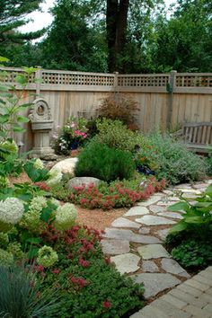 I love this garden design for the backyard!  Beautifully landscaped but with no grass to cut.