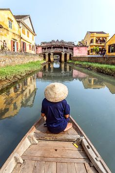 Old man looking at the famous Japanese bridge in Hoi An, Vietnam