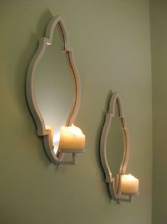 Cute sconces with candles.  These would cover up the holes in the wall left from previous window treatments, stains, etc.