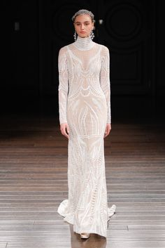 Naeem Khan just sent his spring 2017 bridal collection down the runway and, goodness, it's gorgeous. Click to see all the full-length pictures of long-sleeve dresses, off-the-shoulder gowns, short hemlines, and even a black wedding dress.