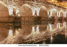 Roman bridge over Guadiana River at night, Merida, Spain