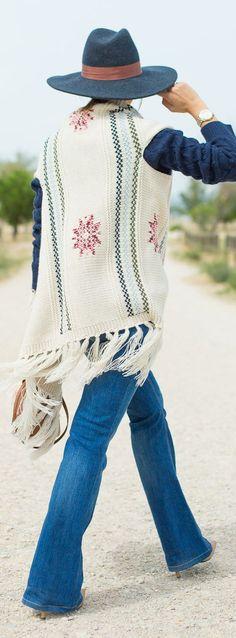Knitted #boho fringed vest + #jeans #streetstyle