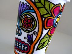 Inspired by Mexican folk art and Day of the Dead imagery, this hand painted eco-friendly ceramic travel mug with silicone lid is a perfect alternative to the wasteful paper cups at chain coffee shops. MEMBER - sewZinski