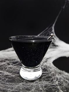 A shimmering Halloween/Galaxy cocktail made from black vodka & edible shimmer dust.