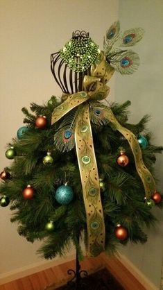 - Christmas tree ideas, Christmas tree decor for your rustic or farmhouse, unique but cute vintage Christmas tree ideas Corner Christmas Tree, Mannequin Christmas Tree, Dress Form Christmas Tree, Peacock Christmas, Christmas Tree Themes, Noel Christmas, Xmas Tree, All Things Christmas, Christmas Tree Decorations