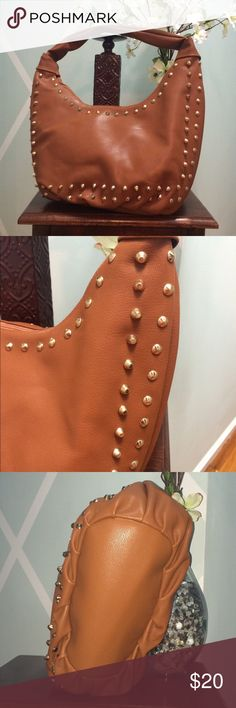 """NWOT- Vegan Studded Handbag No flaws, all studs in tact. One zippered storage pouch and two open pouches. Very clean. Dimensions 16""""across x 9""""deep x 6""""wide. Strap drop 12"""" Bags Hobos"""