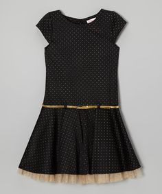 Little sweeties will look enchanting in this shiny dress. Shimmering gold dots look like stars in a night sky, while a gold belt and peek-a-boo tulle add a dash of whimsy. A back zipper makes changing for any party easy. Body: 96% polyester / 4% spandexLining: 100% polyesterMachine wash; tumble dry
