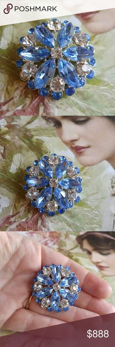 Beautiful vintage rhinestone brooch blue This lovely vintage brooch has sparkly sky blue and clear rhinestones set in silver tone metal. It is in very good condition. It is missing one stone, which is not very noticible. From a smoke free home. Offers welcome:)  moonF8388blue7d6d Vintage Jewelry Brooches