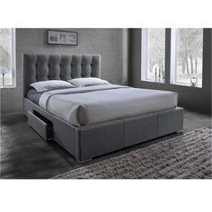 The Sarter platform bed features a grey fabric upholstered headboard with grid tufting. Finishing the look is a rubber wood frame, foam padding, and grid tufting. The bed features 2 storage drawers, allowing all of the clusters to go into these drawers.