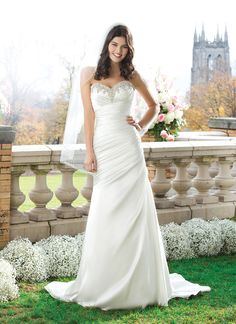 Sincerity wedding dress style 3757 This A-line gown has an asymmetrically draped charmeuse beaded  sweetheart neckline. The gown ends with a chapel length train and  features charmeuse buttons over the back zipper.