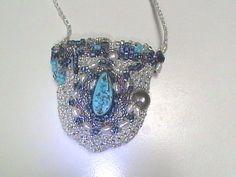 Embellished crocheted amulet bag