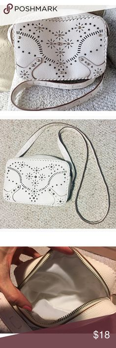 Express small crossbody bag Express small handbag/crossbody bag with grommet detail, like new! Inside is clean with exception of a teeny tiny lipstick stain, hardly noticeable.  This purse is pretty tiny but large enough to fit a compact, lipstick, phone, your cash/cards & maybe a few other things.  Very cute. Express Bags Crossbody Bags