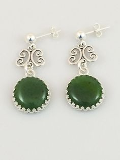 These simple yet elegant post earrings are made with jade cabochons set in sterling silver bezel with sterling silver filigree. They hang from sterling