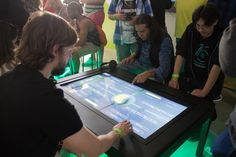 Also inside the music-streaming service's activation, guests could play music trivia through touch-screen social tables, designed by Beak La... Photo: Nadia Chaudhury/BizBash