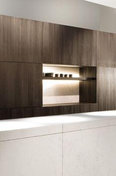 White marble kitchen island + dark wooden cabinets.