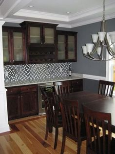 Contemporary Dining Room With Built In China Cabinet And Wine Refrigerator