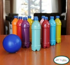 Make bowling pins using bottles and paint. Pour paint into bottles and shake