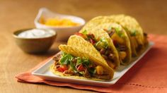 Slow Cooker Pineapple-Pork Tacos Give a Mexican standard a Caribbean edge when you fill ready-made taco shells with slow-cooked pork, pineapple, and lime along with traditional fillings. Crock Pot Slow Cooker, Slow Cooker Recipes, Crockpot Recipes, Cooking Recipes, Pork Recipes, Meal Recipes, Yummy Recipes, Free Recipes, Recipies