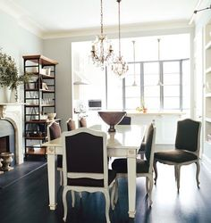 Such a classy look...light walls and an abundance of natural light from the windows along with the contrast of the sleek dark flooring...LOVE!