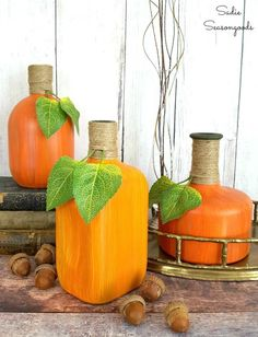 Painting Glass Jars and Bottles to Look Like Decorative Gourds for Fall painted .Painting Glass Jars and Bottles to Look Like Decorative Gourds for Fall painted glass bottle crafts Painting Glass Jars and Bottles to Glass Liquor Bottles, Liquor Bottle Crafts, Painted Glass Bottles, Decorated Bottles, Decorative Glass Bottles, Crafts With Glass Bottles, Fall Wine Bottles, Colored Glass Bottles, Recycled Glass Bottles