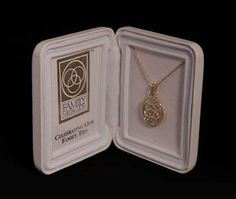 """The perfect wedding ceremony accessories and gifts for kids in blended families. Three rings delicately intertwined symbolize family unity. Present to children forming a stepfamily during your wedding ceremony or for wedding vow renewal ceremony. Each medallion jewelry gift arrives beautifully packaged and includes matching 20"""" chain and photo display case. Presentation ceremony comes with each order."""