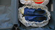 The Very Best Way to Pack Your Sneakers in a Suitcase