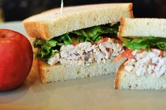 Panera Bread Restaurant: Napa Almond Chicken Salad Sandwich  1 can (13 oz.) canned chicken breast, drained  1/2 cup Mayonnaise  2 tablespoons extra virgin olive oil  1/3 cup finely chopped almonds  1/3 cup finely chopped grapes  1 dash of garlic powder  1 dash chili powder  salt and pepper to taste