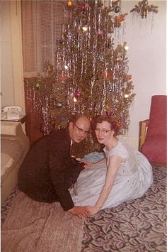 1960's Christmas....Sweet sweet love under The Christmas Tree...Ed and Edna...